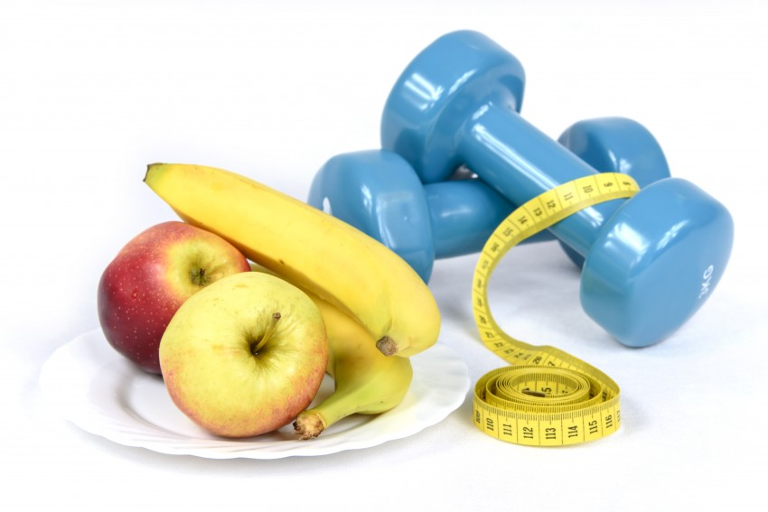 workout nutrition fruit carbohydrates tape measure and dumbbells